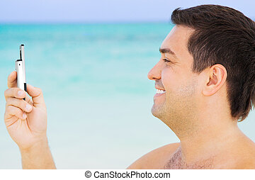 happy man with cell phone - picture of happy man with cell...