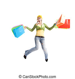 Happy caucasian girl jumping with shopping bags - A...