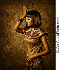 Beautiful egyptian woman bronze portrait over grunge dark...