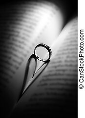Ring with heart-shaped shadow.