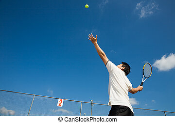 Asian male playing tennis - A sporty young asian male...