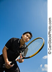 Asian tennis player - A young sporty asian tennis player...