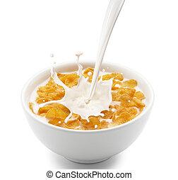 corn flakes with milk splash - pouring milk into corn flakes...