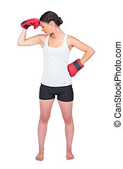 Healthy model with boxing gloves posing on white background