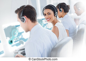 Pretty call center worker using futuristic interface...