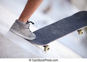 Foot and skateboard