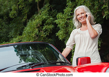 Smiling mature woman having phone call - Smiling mature...