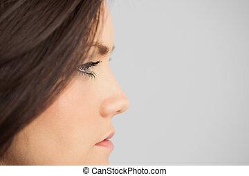 Brunette looking away