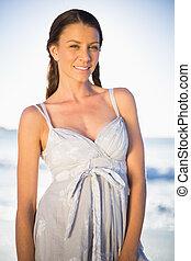 Happy model in summer dress posing