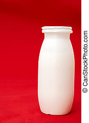milk cans on a red background