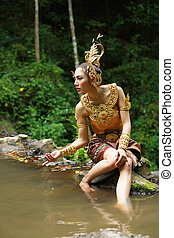Beautiful Thai lady in Thai traditional drama dress, posing...