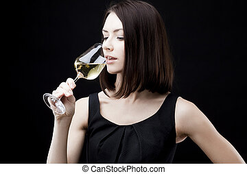 woman holding wine glass - young beautiful woman holding...