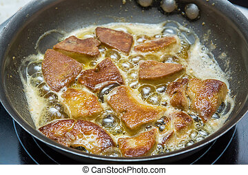 Cooking foie gras - Close up foie gras cooking in iron pan