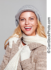 Woman in fall fashion smiling isolated on grey