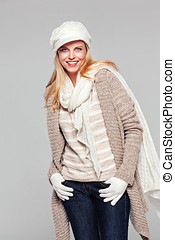 Beautiful lady in fall fashion isolated on grey