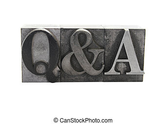 Q and A in old metal type - old, inkstained metal type...