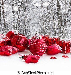red christmas balls in snowed forest - red christmas balls...