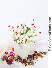 Bleeding-heart flower in vase with dry flower background