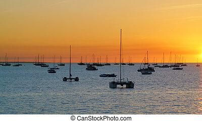 Darwin - Australia - Catamarans in a bay at sunset over sea....