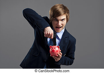 Killing the economy - Businessman holding and pointing a gun...