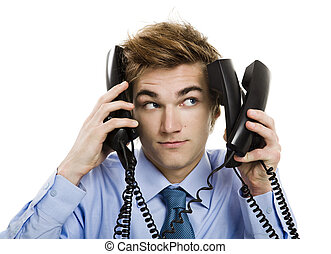 Answering multiple calls at the same time - Young man in the...
