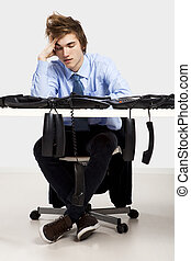 Tired man in the office - Tired businessman sitting in the...