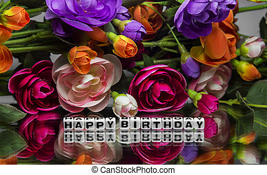 Happy birthday message with flowers.