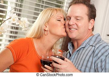 Kissing Couple Enjoying Wine