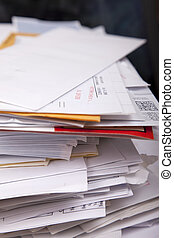 return check pile - A return check notice on top of a pile...