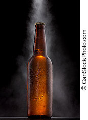 Cold beer bottle with drops, frost and vapour on black