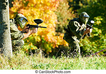 two paintball players - Two paintball sport players in...