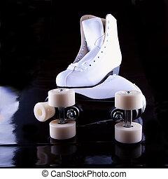 Skates - A pair of white roller skates over black background