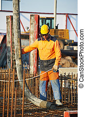 builder worker at concrete pouring work - builder worker...
