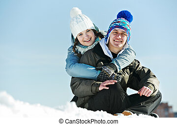 Young couple in winter - Smiling young couple in warm...