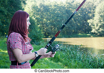 Redhead woman with fishing pole