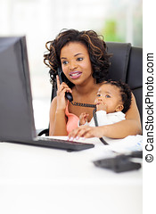 young african american businesswoman with baby at office -...