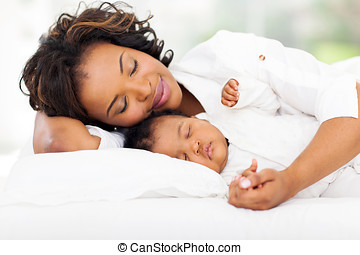 african mother and baby sleeping - cute african mother and...