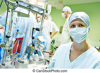 surgery nurse at operation - Surgery nurse in uniform...