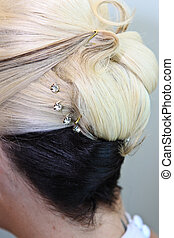 Hair Do - A blonde and brown hair do done up in a bun for a...