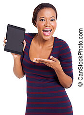 young african woman presenting tablet computer - excited...
