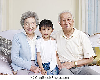 grandparents and grandson - portrait of grandparents and...