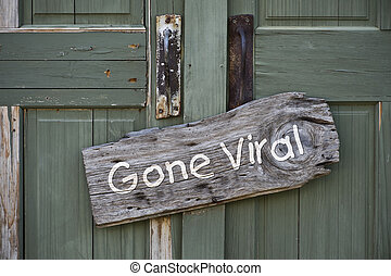 Gone Viral Sign - Gone viral sign on old antique doors