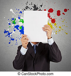 businessman with blank book and splash colors choice as...
