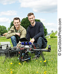 Engineers With Laptop And Digital Tablet By UAV - Portrait...