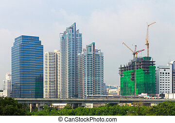 High condominium, Business and constructing building behind...