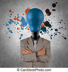businessman with lamp-head and splash colors as concept...