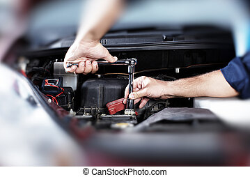Auto repair. - Hands of car mechanic in auto repair service.
