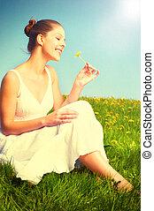 Happy woman in meadow.