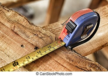 Measuring tape on the wood