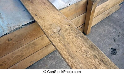 Sawing the plank with a hand saw, closeup view